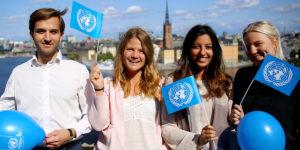 Fyra unga medlemmar i FN-rörelsen